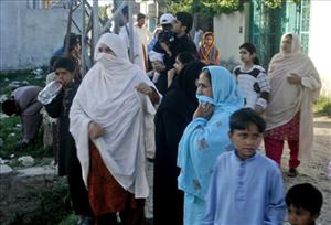 Local residents gather to view the house of Osama bin Laden, in Abbottabad, Pakistan, on Sunday, May 8, 2011.