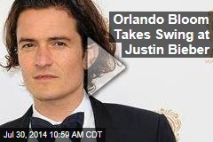 Orlando Bloom Takes Swing at Justin Bieber